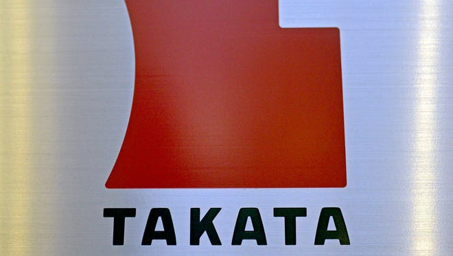 A file picture dated 11 April 2013 shows the logo of Japanese auto-parts supplier Takata Corp. at the company Tokyo headquarters in Tokyo, Japan.