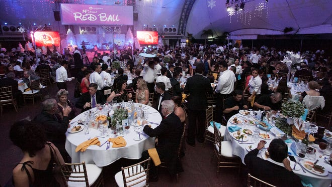 Hundreds of people dressed in suits and evening gowns attended the 14th annual Red Cross Red Ball on Sept. 20, 2014 at Pacific Islands Club in Tumon. This year's theme is Disney-inspired.