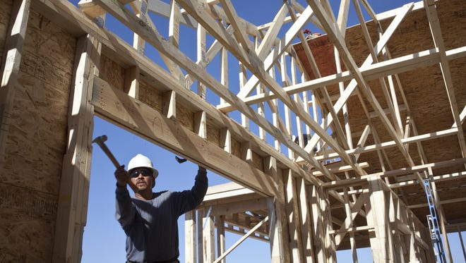 A shortage of construction workers, like this one working for Meritage Homes Corp., is making it hard for developers to respond to the demand for new homes.
