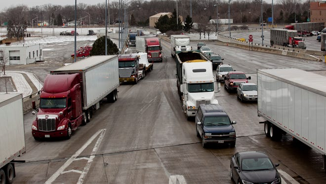Trucks and vehicles wait to cross into Canada at the Blue Water Bridge in Port Huron.
