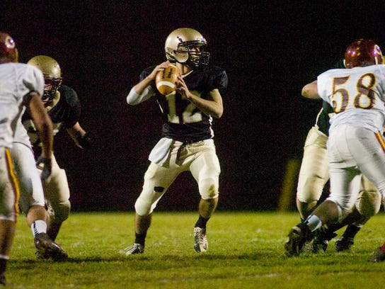 Delone Catholic QB Brett Smith had a big night rushing and passing Friday vs. Columbia in the District 3 Class A semifinals. (The Evening Sun -- Shane Dunlap)