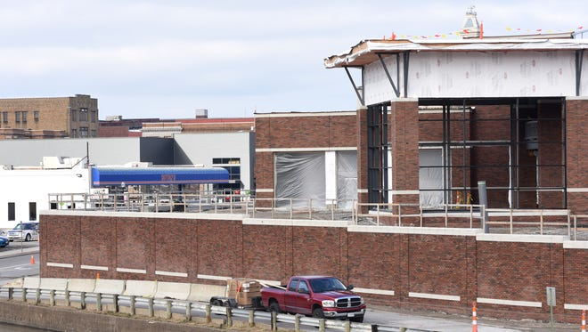 The new Dutro auto dealership rises on South Street in Zanesville in a recent picture. The new building was one of an increasing number of commercial permits in the area over the last year. Vehicle sales, mostly in the form of trucks, also rose.