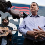 Republican presidential candidate Ohio Gov. John Kasich speaks to the media alongside musician Rod Webber during a campaign stop at the Derry-Salem Elks Lodge on Sunday.