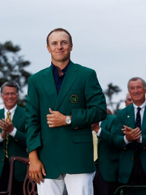 Jordan Spieth poses with his green jacket Sunday after winning The Masters golf tournament at Augusta National Golf Club.