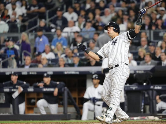 Gary Sanchez watches his seventh inning solo home run