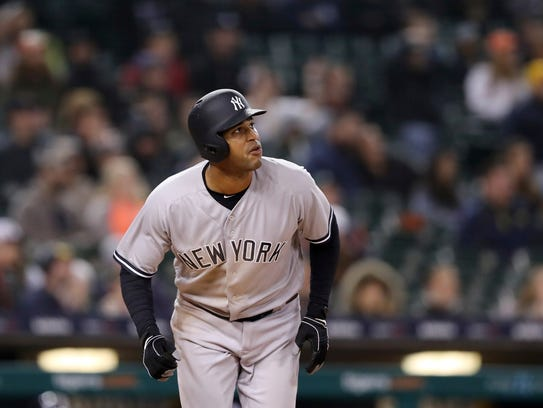 New York Yankees' Aaron Hicks watches the path of his