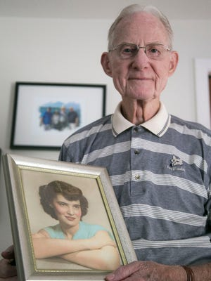Ralph Hedrick holds a portrait of his late wife, Geneva, in their family home near Mansfield. Geneva worked for 36 years at OhioHealth Mansfield Hospital until she retired as a housekeeper at age 88.