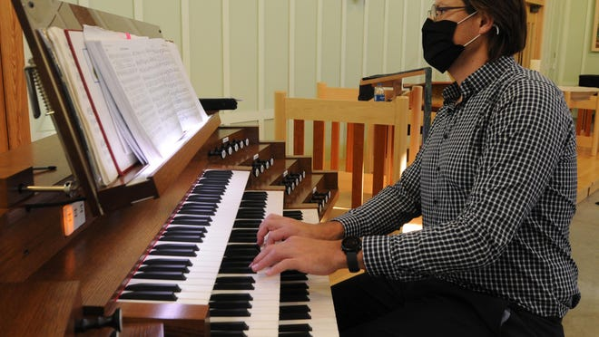 Hentus van Rooyen, sacred music coordinator and college organist, plays on the new Rodgers Artist Series 599T digital organ in Pearson Chapel at Bethany College.