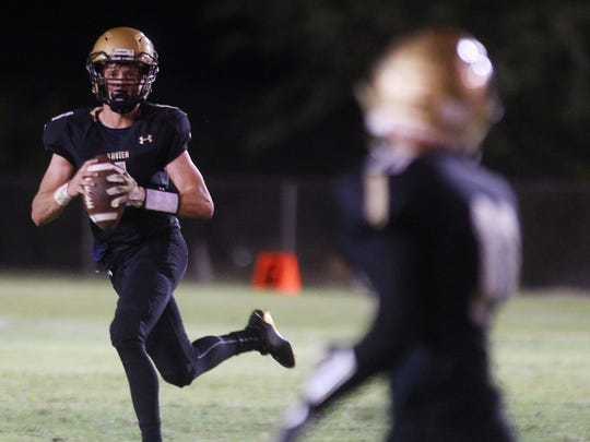 Xavier Prep junior Thomas Branconier drops back to pass against Cathedral City High School for their homecoming game in Palm Desert on September 29, 2017.