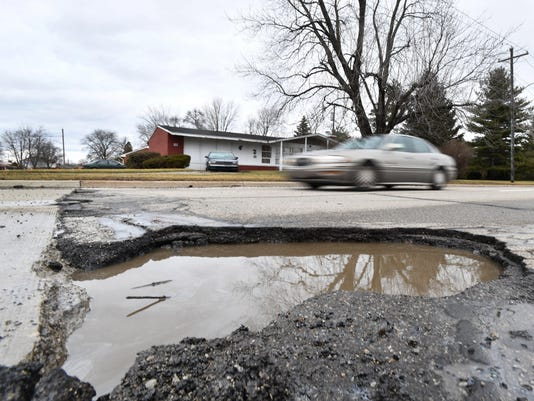 2018-0221-dm-pothole1