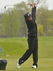 Following through after a tee shot is Plymouth junior