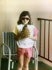 Aimee Suprenant holding her first pineapple at Fresh