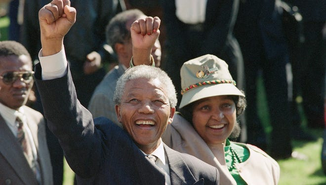 Nelson Mandela and his wife, Winnie, greet a crowd in 1991.