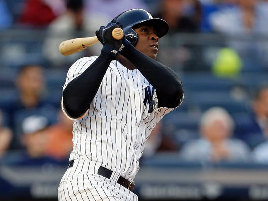 Yankees shortstop Didi Gregorius (18) watches a solo home run against the Kansas City Royals during the third inning at Yankee Stadium.