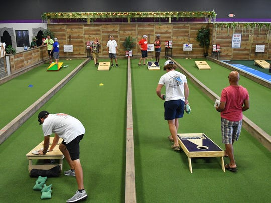 The Backyard in Palm Shores hosts their first annual Cornhole Tournaments July 21, 22. About 30 teams competed on Saturday.