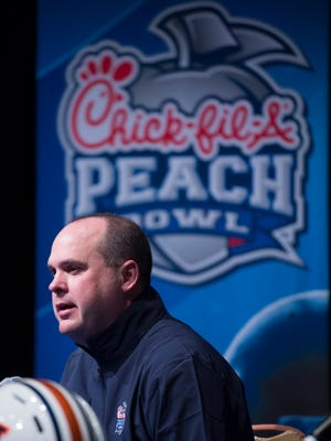 Auburn offensive coordinator Chip Lindsey speaks during the Auburn's Peach Bowl offensive press conference on Dec. 30, 2107, in Atlanta, Ga.