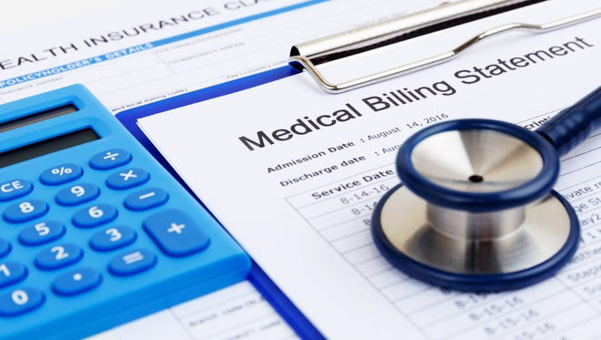 Medical bill and health insurance form with calculator.