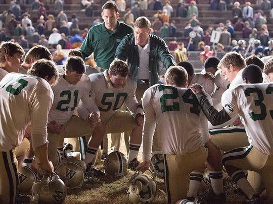 """Woodlawn"" is based on the true story of an Alabama high school football team that learned praying together was the key to playing together."