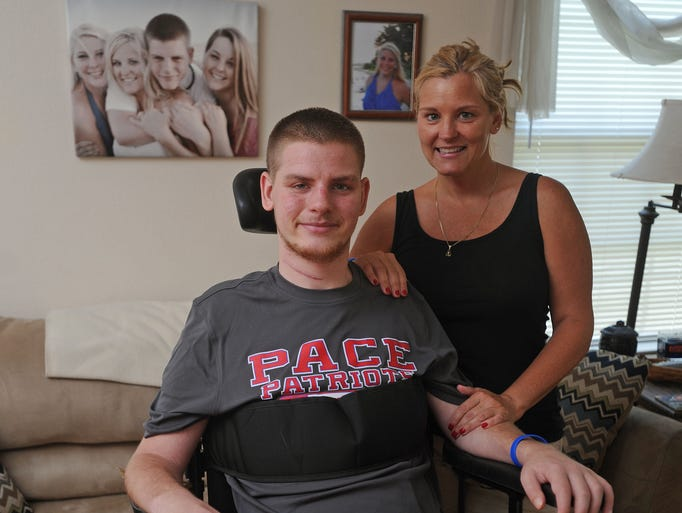 Logan Cannon with his mom Kim at their Pace home. Logan, a Pace High School graduate, was paralyzed on an end of the school year swimming trip.