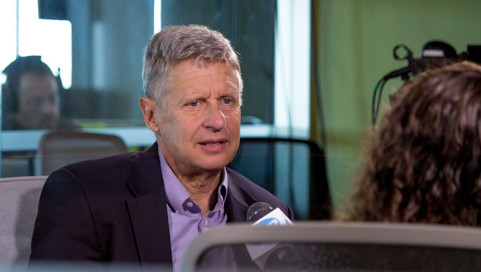 Libertarian presidential candidate Gary Johnson, left,