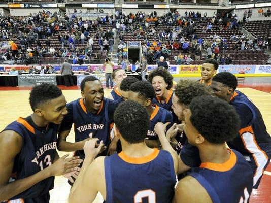 The William Penn boys basketball team celebrates their Class AAAA 56-53 championship victory over Cedar Crest High School in Hershey, Pa. on Saturday, Feb. 28, 2015.  Jason Plotkin - Daily Record/Sunday News