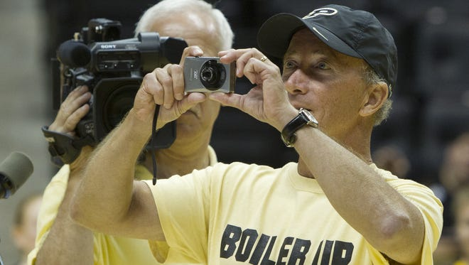 Then Gov. Mitch Daniels takes a photo of incoming students during the Boiler Gold Rush Boiler Up Rally on Aug. 13, 2012, at Mackey Arena.