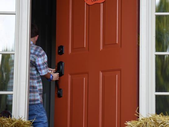 Ben Gabbert, 6, enters his new home in Milford.