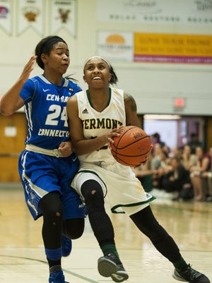 Vermont's Andreana Thomas (22) drives to the hoop past during a game earlier this season at Patrick Gym.