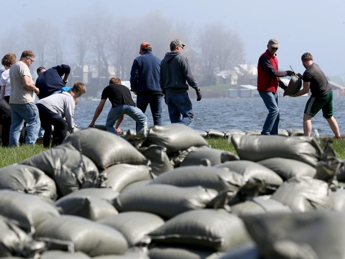 Resident volunteers sandbag homes in Sodus Point as