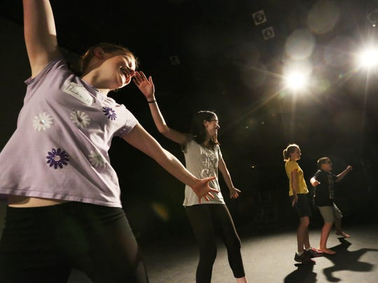Capitol Civic Center's theater arts camp participants Audra Hampton-Gregory, left, Emma Winkel, Amelie Doneff and Teak Prigge practice their group's dance movement at UW-Manitowoc on Tuesday, June 21.
