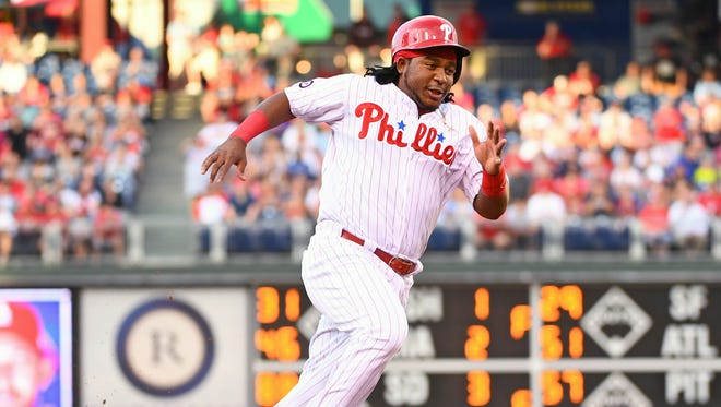 Philadelphia Phillies third baseman Maikel Franco runs towards third base as he scores a run during the first inning against the St. Louis Cardinals at Citizens Bank Park.