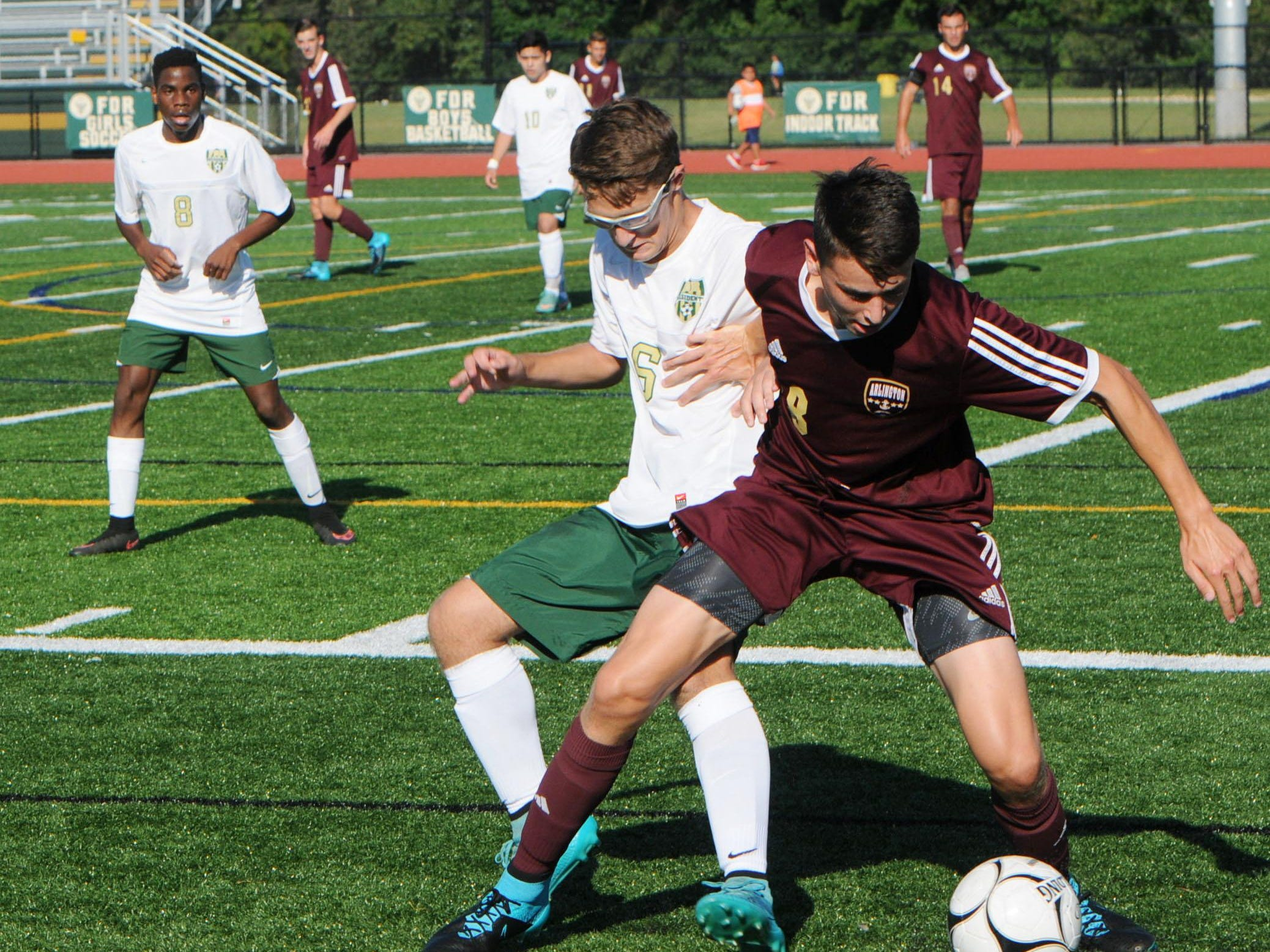 Arlington's Travis Cartica, right, tries to keep the ball away from FDR's T.J. Illuminate, left.