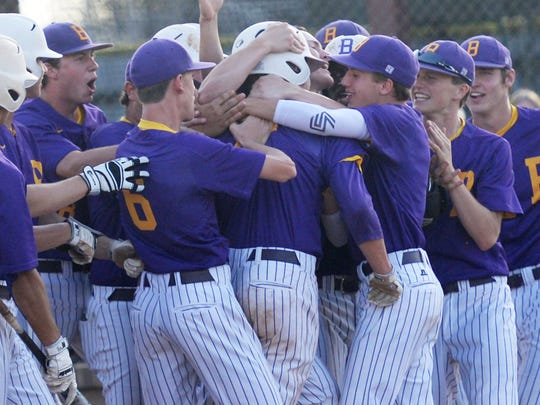 Byrd players celebrate Trent Touchet's first-inning