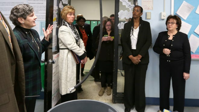 State Education Commissioner MaryEllen Elia, far right, visits a classroom that has been closed because of a leaky roof at Ramapo High School Feb. 10, 2016.