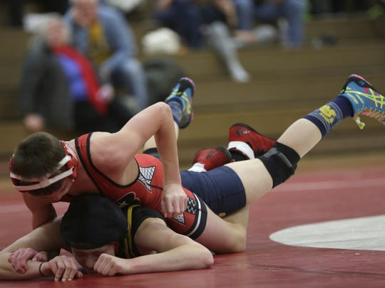 Wisconsin Rapids' Cale Benitz (top) earned an 8-6 decision over Caden Dennee of Marshfield at 132 pounds to clinch a 33-32 Wisconsin Valley Conference dual meet win for the Raiders on Dec. 13.