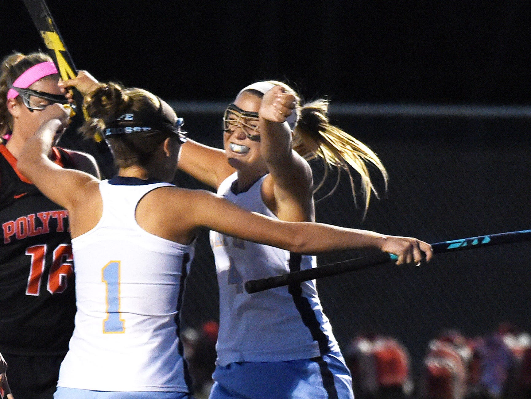 Capes Sydney Ostroski celebrates after scoring as Cape Henlopen HS (white) hosted Polytech HS (black) in Varsity Field Hockey at Champions Stadium at the school near Lewes on Thursday October 22.
