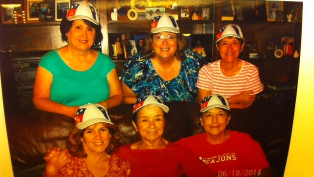 Cheryl Broussard Perret submitted this photo of herself, her sister, her aunt and three cousins who are all traveling to CMA 2014.
