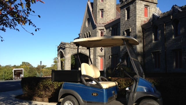 A golf cart is parked in front of Whitby Castle at Rye Golf Club in 2012. A scandal at the club prompted City Manager Scott Pickup to resign, and the former general manager, Scott Yandrasevich, was arrested on grand larceny charges.