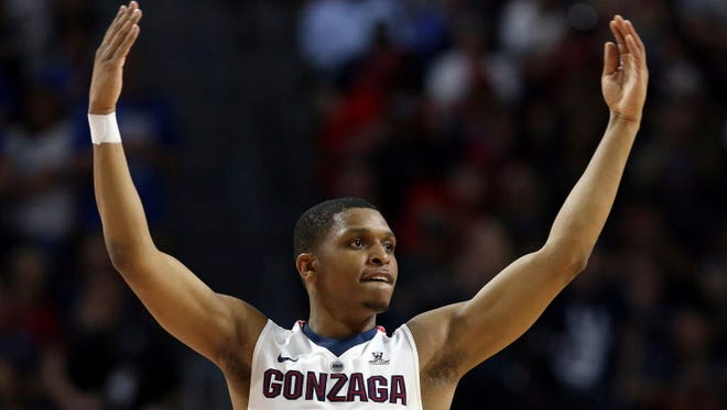 Gonzaga's Zach Norvell Jr. raises his hands to the crowd during the first half of the West Coast Conference tournament championship.