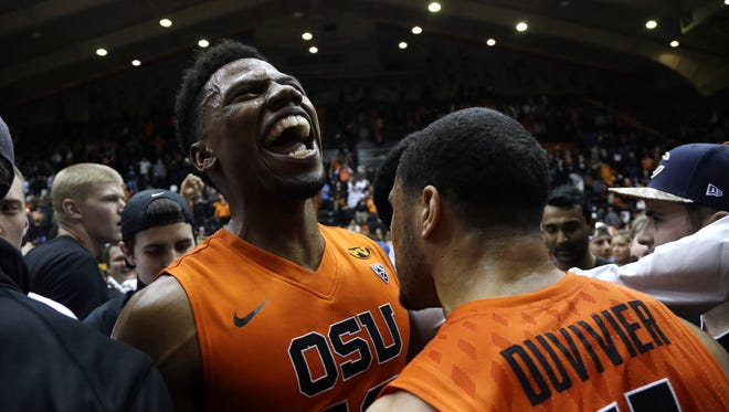 Oregon State guard Langston Morris-Walker, left, celebrates with teammate Malcolm Duvivier after winning an NCAA college basketball game against Arizona in Corvallis, Ore., Sunday, Jan. 11, 2015.  Oregon State beat No. 7-ranked Arizona 58-56.