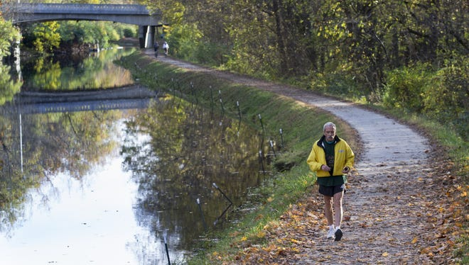 Fred Standeford of Indianapolis runs along the Central Canal Towpath, next to the Newfields grounds, on a warm day in November 2015.