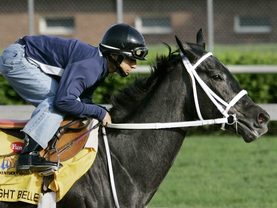 Kentucky Derby hopeful Eight Belles, with jockey Gabriel Saez aboard, works out on the Churchill Downs track in Louisville, Ky., Sunday, April 27, 2008. (AP Photo/Ed Reinke)