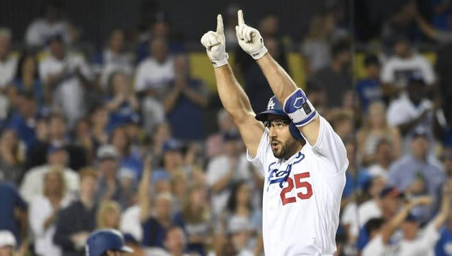 Dodgers third baseman Rob Segedin (25) reacts after hitting a solo HR against the San Francisco Giants at Dodger Stadium on Aug. 23, 2016.