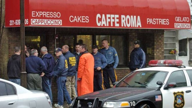 Police seize equipment during a Dec. 1, 2004, raid on Caffe Roma in East Rutherford as part of Operation Jersey Boyz, a joint investigation by the Bergen County Prosecutor's Office and state police.