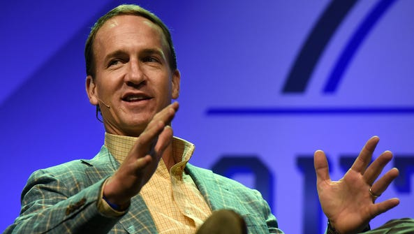 Peyton Manning answers questions during Argus Leader