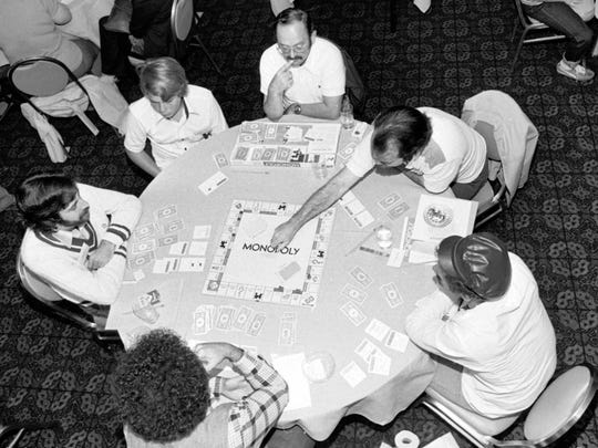 Regional Monopoly fans in Chicago test their skills, Sept. 8, 1979, in the hopes of competing in the World Monopoly Championships next year.  The championship will be held in New York in November.  (AP Photo)
