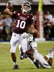 Mississippi State quarterback Keytaon Thompson (10) throws a 27-yard touchdown pass as a Stephen F. Austin defender attempts to tackle him during the first half of their NCAA college football game, Saturday, Sept. 1, 2018, in Starkville, Miss. (AP Photo/Rogelio V. Solis)