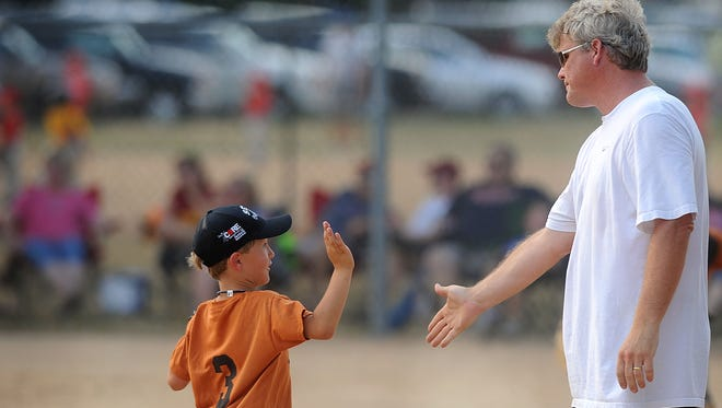 Stu Whitney encourages one of his players in this 2012 photo at Covell Park in Sioux Falls.
