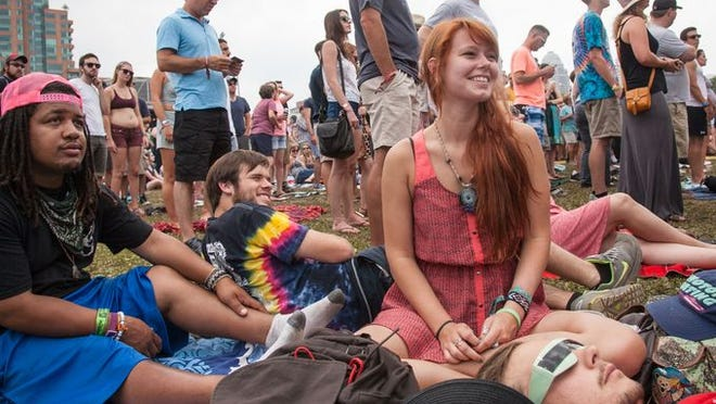 Averi Washington, far left, Adam Hatson, Lacy Browning, and Jeremy Clark Evans watch Lucius at the Mast Stage. July 20, 2014