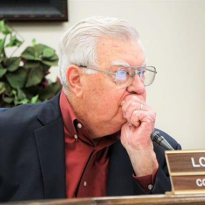 Nueces County Judge Loyd Neal listens to a presentation